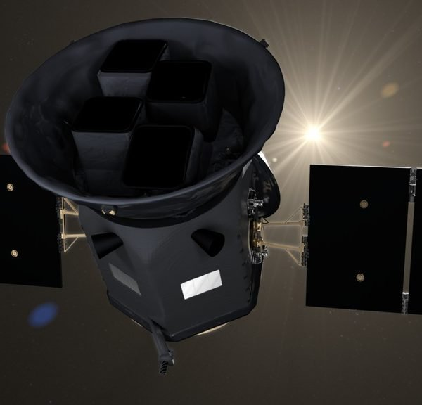 TESS satellite in space, backlit by the sun.